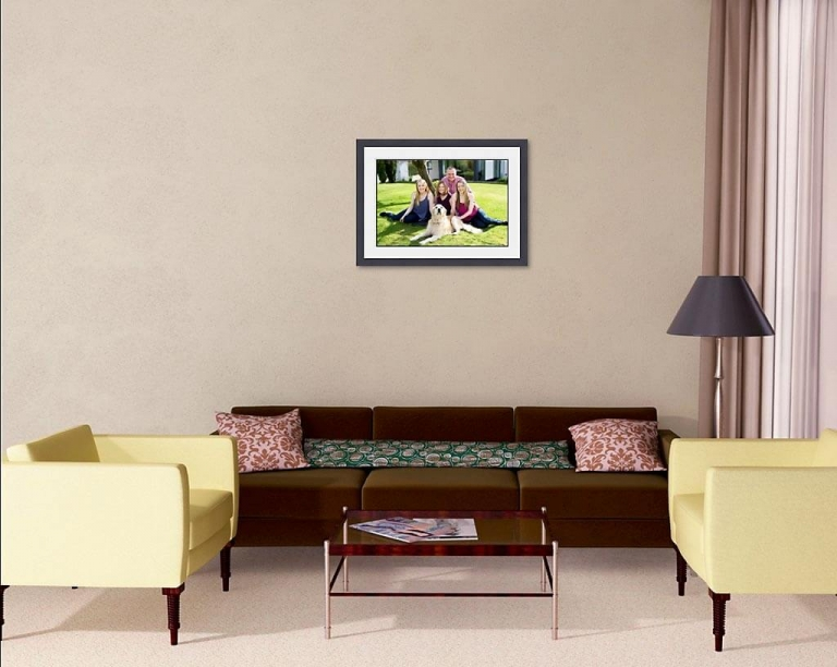 Image of family lounge with framed family wall portrait