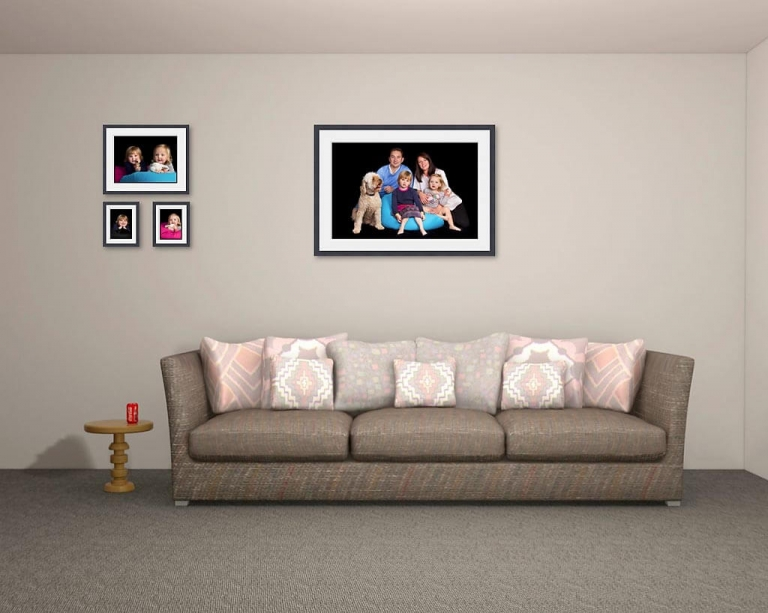 Image of a grouping of family wall portraits in the family lounge
